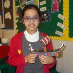 Zaina constructing a Viking longship April
